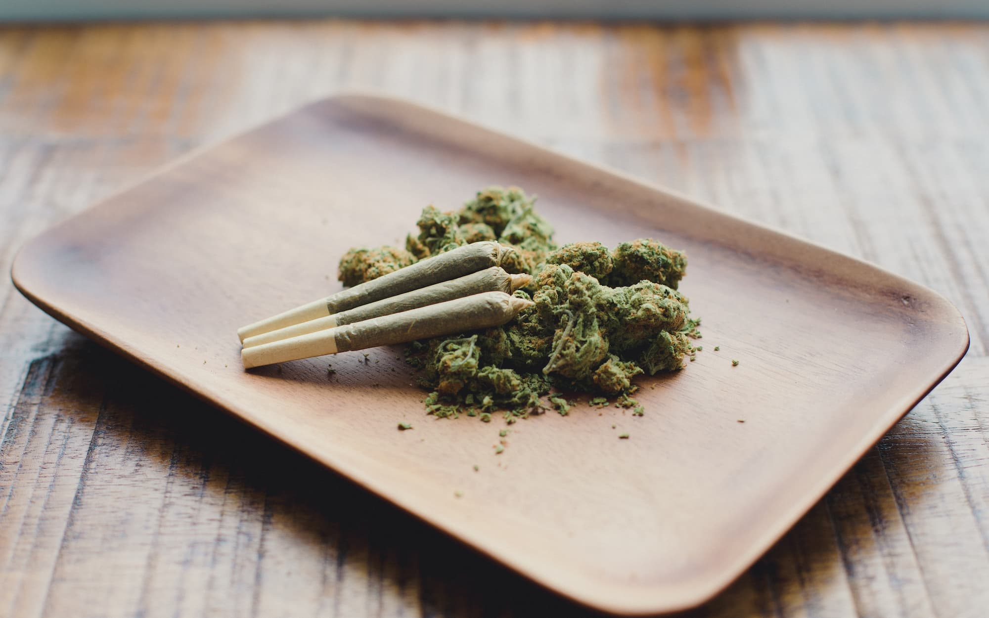 cannabis rolling tray with cannabis and 3 pre rolled joints